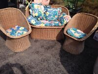 Wicker loveseat and tub chairs