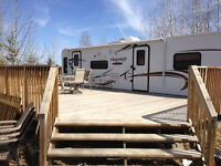 Travel trailer with lake lot