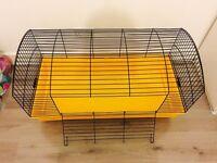 Rabbit Cage, Half Bag of Bedding + Toys.