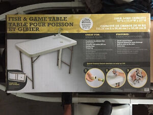 Unopened brand new fish and game table $ 70 obo.