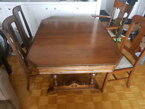 Antique solid wood dining table, extendable.