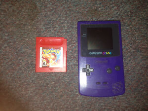 Purple Game Boy Color with Pokemon Red