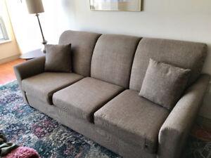 Brown Three-Seater Fabric Couch