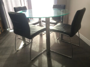Modern glass table and leather chairs