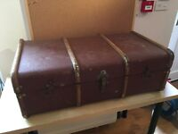 Vintage travel trunk. Leather with wood detail