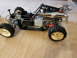 4- RC 1/5 Gas Monster Trucks And Buggys