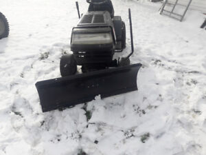 Lawn tractor with snow plow.