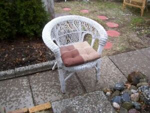 Wicker Chair with brown pillow cushion