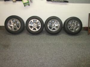 """17"""" jeep liberty wheels, tires excellent condition"""