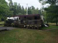 30 foot park model trailer sleeps 6 on lot on Duck Lake