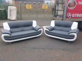 Brand new ex display 3 &2 seater sofa in grey& white leather £499