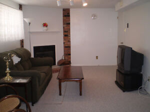 Large, quiet basement apartment for FEMALE student