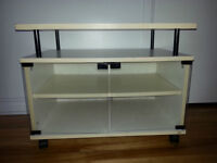 Cabinet with glass doors  and wheels in good condition