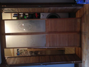 Set of bifold closet doors with stained glass