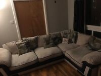 Large cream corner sofa with scatter back