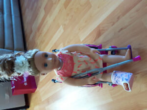 Wheel chair and doll
