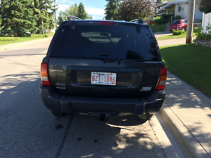2004 Jeep Grand Cherokee *extra tires*$3300obo