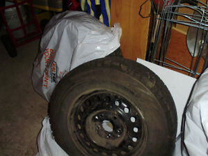 2  nearly new  WS 80 225/16/R65Blizzack Winter Tires and 4 rims