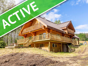 BEAUTIFUL LOG HOME ON 320 ACRES