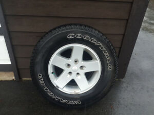 Tire and Rim off jeep jk like new condition never used.