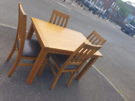 47. Solid oak table and chairs