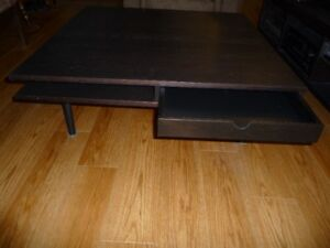 Square Ikea coffee table with shelves and drawers