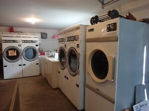 coin op laundrymat  gas dryers and 9 coin op washing machines