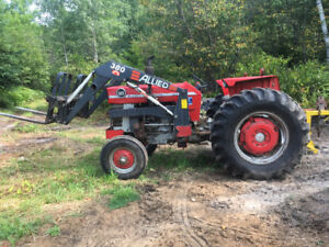Massey 165 tractor loader, forks, snow blower and tire chains.