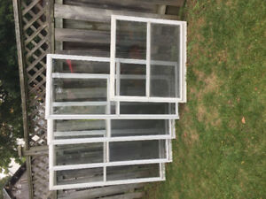 White vertical sliding storm windows (with screens)