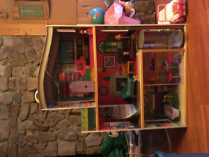 Large Barbie house and extensive collection