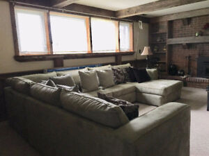 Amazing condition sectional Sofa includes queen size sofa bed