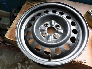 Never used 16 by 7 inch 4 bolt pattern rim
