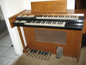 Upright electric organ - works well .....$ 150