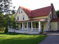 Magnifique maison centenaire à Mille-Isles