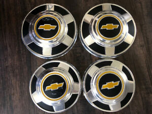 "4 X  CHEVY HUBCAPS ( NEW ) 2 X 10 3/4 and 2 X 12"" DIAMETER."