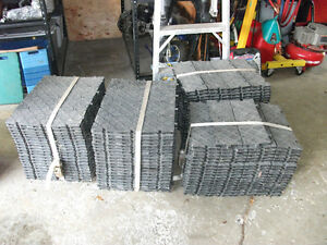 Interlocking plastic flooring