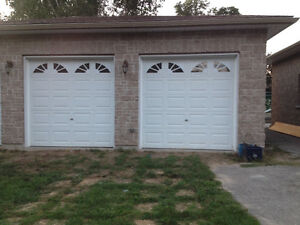 Two 8x8 garage doors white with windows