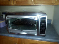 Oster Toaster oven with digital display.