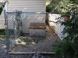 insulated dog house, chain link fence and gate