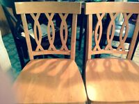 Pub style table and 4 chairs,,table could use a little redone..