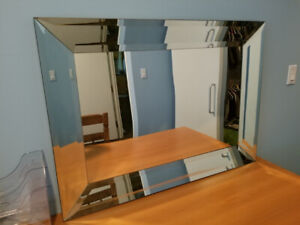 Large bevelled glass mirrors