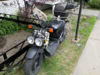 2005 Honda ruckus grey camouflage with trunk and helmet