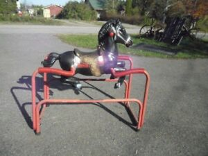 BLACK STALLION ROCKING HORSE IN GOOD CONDITION. [FIRM]