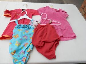 Swimsuits and cover-up. Sizes and prices in description.