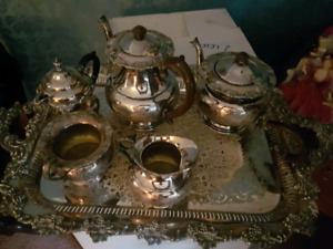 Silver tea sets and misc. Pieces