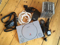 PlayStation 1 (PS1) with leads and games