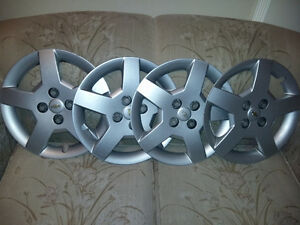 "Four 16"" Wheel Covers"