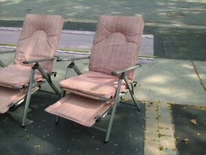 2 Reclining padded chairs from Camping World with covers