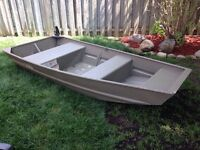 10 foot Jon boat with 4 hp mercury engine and accessories