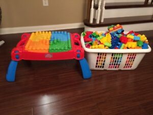 Mega blocks table and large basket of Lego